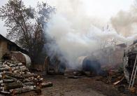 На території колишнього льонокомбінату силовики викрили підпільний цех з випалювання деревного вугілля. Фото